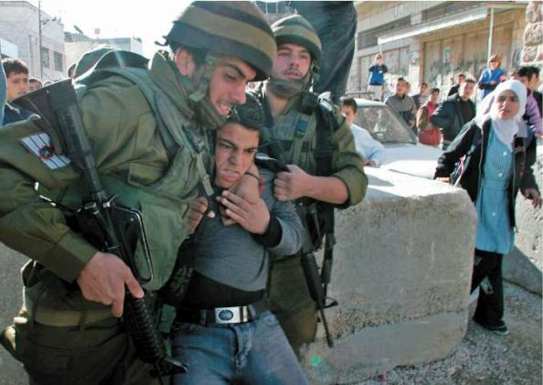 PIsraeli soldiers detain a Palestinian student during a protest in Hebron in 2005. Hebron is the only Palestinian city whose centre is directly controlled by the Israeli military
