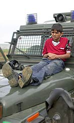 Palestinian child used as a human shield by Israeli soldiers.