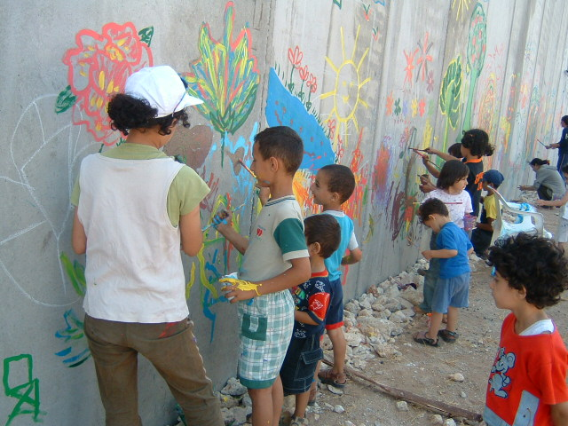 Children Paint The Wall With Brightly Colored Flowers, Suns, And Other  Images. Part 34