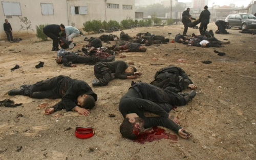 Many bodies lie outside the Hamas police headquarters following an Israeli air strike in Gaza City on December 27, 2008. (MOHAMMED ABED/AFP/Getty Images)