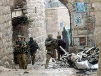 Israeli soldiers invade a Palestinian city.